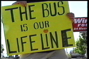 protest sign says the bus is our lifeline